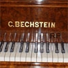 One of the Bechstein grand and upright pianos